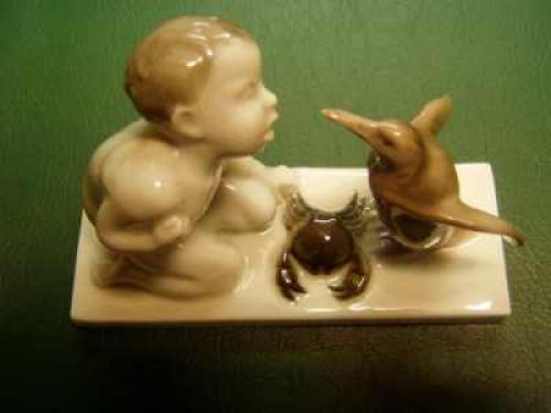 Porcelánové soušoší Chlapec a tučňák Rosenthal